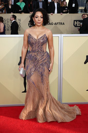 Selenis Leyva got majorly glam in this strapless nude and purple gown by Erika Weise for the 2018 SAG Awards.
