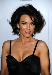 Kelly Carlson showed off bouncy brunette curls while attending the Genesis Awards.