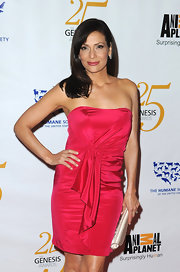 Constance Marie accented her strapless magenta dress with a silver satin clutch.