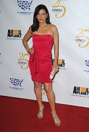 Constance Marie dazzled in strappy champagne criss cross sandals.