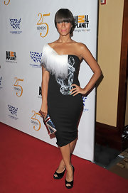 Leona Lewis accented her horse print dress with a pair of classic black patent peep toe platforms.