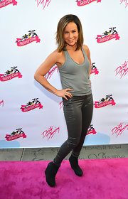Jennifer Grey sported a youthful, edgy look with a pair of black wedge boots, shiny jeans, and a tank top at the 25th anniversary celebration of 'Dirty Dancing.'