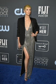 Charlize Theron shimmered in a high-slit, beaded silver dress by Celine at the 2020 Critics' Choice Awards.