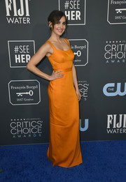 Alison Brie brightened up the blue carpet with this sleeveless orange column dress by Brandon Maxwell at the 2020 Critics' Choice Awards.