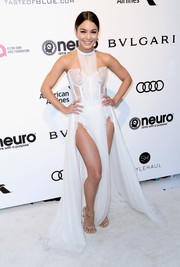 Vanessa Hudgens completed her alluring ensemble with nude ankle-strap sandals by Stuart Weitzman.