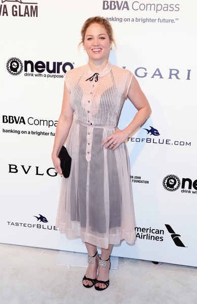 Erika Christensen chose a sheer white shirtdress teamed with a black underlay for the Elton John AIDS Foundation Oscar-viewing party.