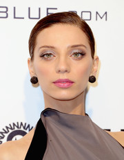 Angela Sarafyan kept it simple with this side-parted chignon at the Elton John AIDS Foundation Oscar-viewing party.