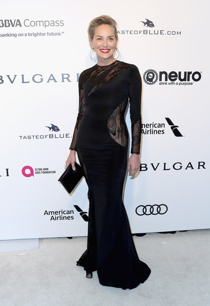 Sharon Stone looked as foxy as ever in a curve-hugging black lace-panel gown by Rubin Singer at the Elton John AIDS Foundation Oscar-viewing party.