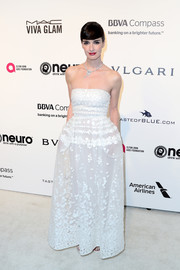 Paz Vega kept it carefree yet chic in a strapless, dotted white gown by Elie Saab at the Elton John AIDS Foundation Oscar-viewing party.