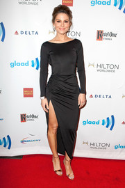 Maria Menounos smoldered in a black evening dress with a thigh-high slit during the GLAAD Media Awards.