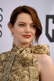 Emma Stone was edgy-glam with her loose bun at the 2019 SAG Awards.