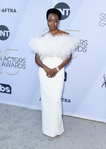 Danai Gurira got majorly glam in a feather-festooned off-the-shoulder gown by Ralph & Russo Couture for the 2019 SAG Awards.
