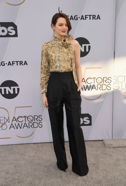 Emma Stone teamed her top with black wide-leg pants, also by Louis Vuitton.