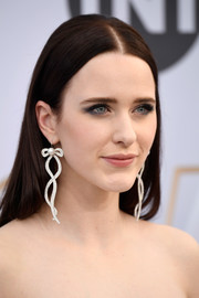 Rachel Brosnahan glammed up her look with a pair of ribbon-motif diamond and pearl earrings by Irene Neuwirth.