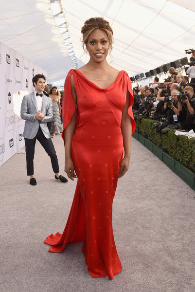 Laverne Cox was vintage-glam in a red cape-sleeve gown by Zac Posen at the 2019 SAG Awards.