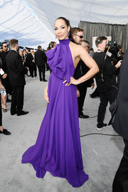 Amanda Brugel attended the 2019 SAG Awards wearing a Redemption halter gown in a gorgeous shade of violet.