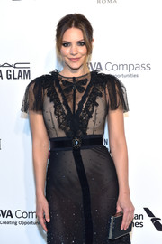 Katharine McPhee attended the Elton John AIDS Foundation Oscar-viewing party carrying a beaded clutch by Judith Leiber.