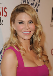 Brandi Glanville attended the 26th Annual Genesis Awards wearing her hair in long sleek curls with side-swept bangs.