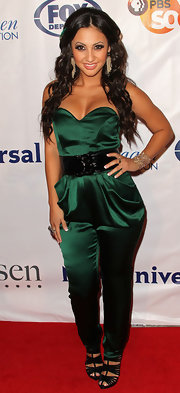 Francia Raisa went green in an emerald jumpsuit with a deep sweetheart neckline at the Imagen Awards Gala.