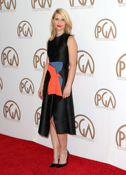 Claire Danes looked lovely in a black wrap dress with bold blue and orange details at the 26th Annual Producers Guild Of America Awards.