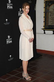 Nicole Kidman complemented her ladylike white dress with strappy gray leather sandals.