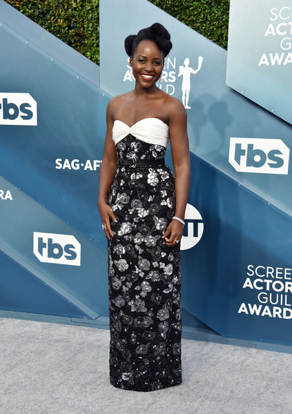 Lupita Nyong'o oozed elegance wearing this strapless monochrome floral gown by Louis Vuitton at the 2020 SAG Awards.