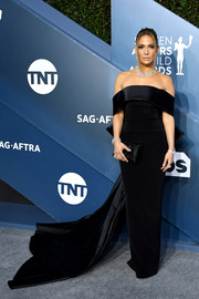 Jennifer Lopez cut a regal figure in a black off-the-shoulder gown with a long train at the 2020 SAG Awards.