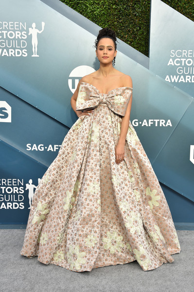 Nathalie Emmanuel was all about sweet glamour in a strapless champagne floral ballgown with an oversized bow accent at the 2020 SAG Awards.