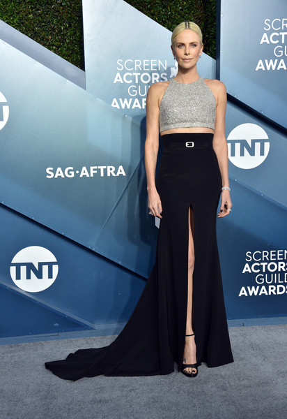 Charlize Theron teamed her sassy top with a high-slit black maxi skirt, also by Givenchy Couture.