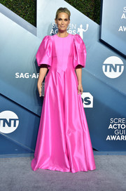 Molly Sims cut a vibrant figure in a hot-pink Rasario gown with puffed sleeves at the 2020 SAG Awards.