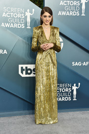 Natalia Dyer glowed in a long-sleeve gold column dress by Saint Laurent at the 2020 SAG Awards.