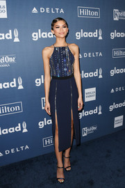 Zendaya Coleman complemented her dress with navy satin ankle-strap sandals by Jimmy Choo.