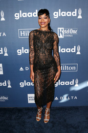 Keke Palmer teamed her sizzling-hot dress with a pair of silver gladiator heels.