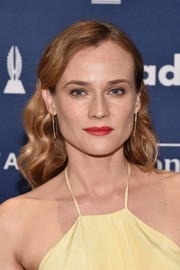 Diane Kruger's red lippy looked lovely against her yellow dress.