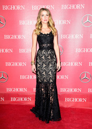 Amber Heard cut a sultry figure in a figure-hugging black lace gown by Dolce & Gabbana at the Palm Springs International Film Fest Awards Gala.