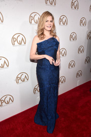 Jennifer Jason Leigh attended the Producers Guild of America Awards looking classy in a strapless blue gown with a sculptural bustline.