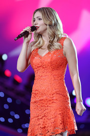 Katharine McPhee cut an ultra-feminine figure in this red-orange lace dress while performing at the National Memorial Day concert.