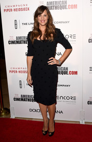 Sticking to her minimal style, Jennifer Garner donned a subtly beaded LBD by Dolce & Gabbana for the American Cinematheque Award.