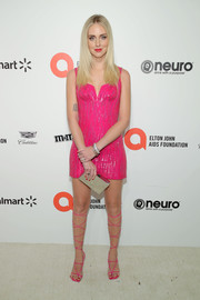 Chiara Ferragni completed her ensemble with a gold box clutch.