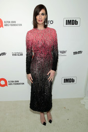 Paz Vega teamed her frock with a pair of PVC-panel pumps.