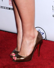 America Ferrera attended the Lucille Lortel Awards wearing simple yet classic bronze peep-toe pumps by Christian Louboutin.