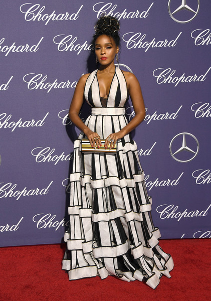 Janelle Monae coordinated her dress with a striped hard-case clutch by Jimmy Choo.