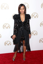 For her bag, Kerry Washington chose a black suede clutch, also by Jimmy Choo.