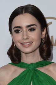 Lily Collins added an extra dose of glamour with a pair of diamond hoops by Anita Ko.
