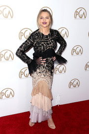 Teresa Palmer looked fancy at the Producers Guild Awards in a J. Mendel Couture beaded gown with ruffle cuffs and a multicolored  tiered skirt.