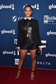 Kiersey Clemons attended the 2018 GLAAD Media Awards wearing a fitted black jacket over a leather vest, both by Louis Vuitton.