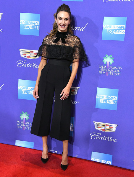Elizabeth Chambers kept it relaxed yet chic in a Self-Portrait capri jumpsuit with a lace yoke and bow detail at the Palm Springs International Film Festival Awards Gala.