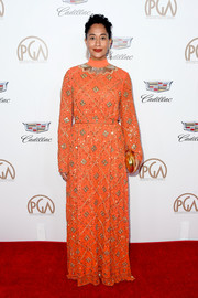 Tracee Ellis Ross went for exotic glamour in this beaded orange gown by Tory Burch at the 2018 Producers Guild Awards.
