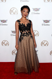 Betty Gabriel attended the 2018 Producers Guild Awards wearing a Rhea Costa gown with an embroidered, illusion-panel bodice.