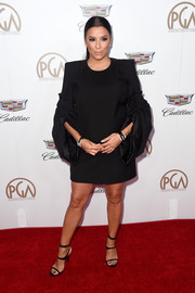 Eva Longoria went for an edgy maternity look in this Saint Laurent LBD with ruched sleeves at the 2018 Producers Guild Awards.
